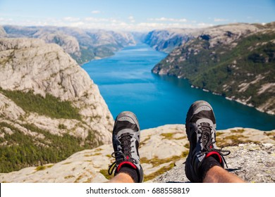Men's legs with hiking shoes. Concept of adventure in Norway.