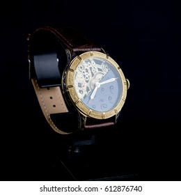 Men's luxury wristwatch on black background
