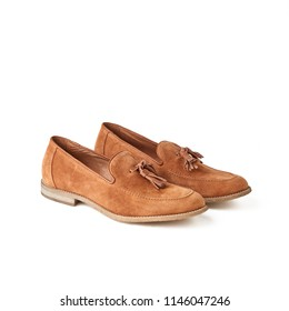 Men's orange brown suede loafers shoes. Studio shot, white background