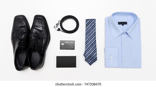 Men's outfits with blue shirt. Clothes shop top view concept