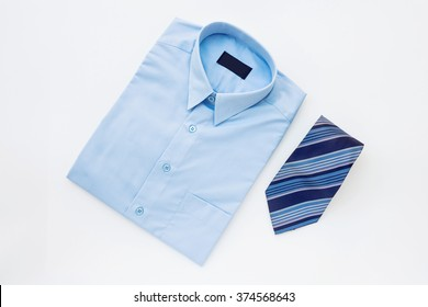 Men's outfits with blue shirt and tie