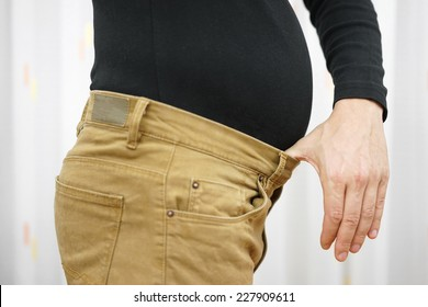 Men's pants are too tight due to the higher weight