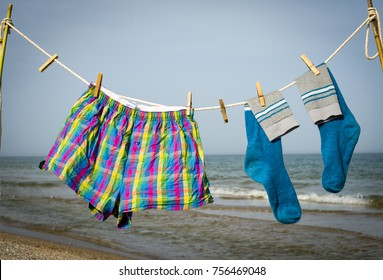 Men's pantyhose dries on a rocker on the beach.. Coast of the Black Sea. Sand spit. Unpopular beach.