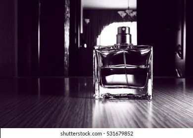 Men's perfume in a glass container.