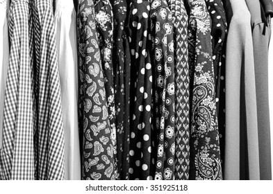 Mens plaid shirts on hangers in a retail store,black and white photo,horizontal photo