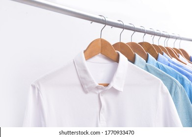 Men's polo-shirt with long sleeved blue shirt on hanger