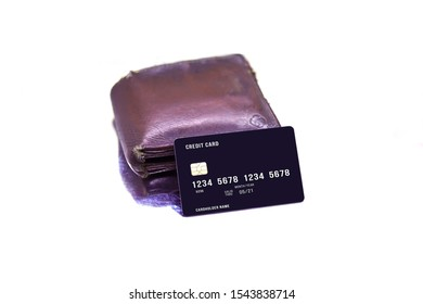 men's purse with credit and debit cards on the white tables