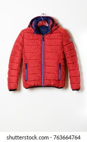 Men's red jacket is a down jacket on hanger, with a zipper. New collection  fall-winter 2017-2018. Close-up.