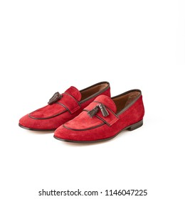 Men's red suede loafers shoes. Studio shot, white background