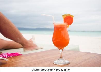men's rest, lie on the beach,  fresh fruit juice on the beach