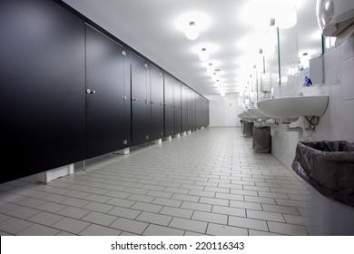 Mens restroom in an public building in white and black doors
