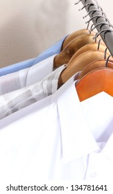 Men's shirts on hangers close-up