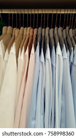 Men's shirts on the metal hangers.