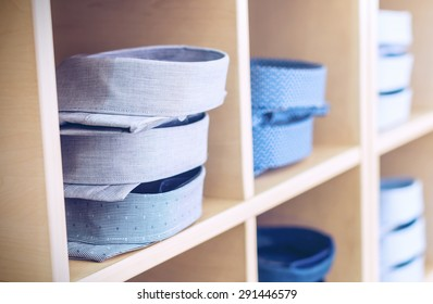 Men's shirts on shelves at a retail store