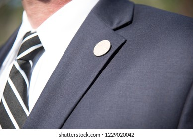 Mens suit Lapel pin closeup of tailored business suit and tie corporate meeting
