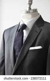 mens suit, suit on bust