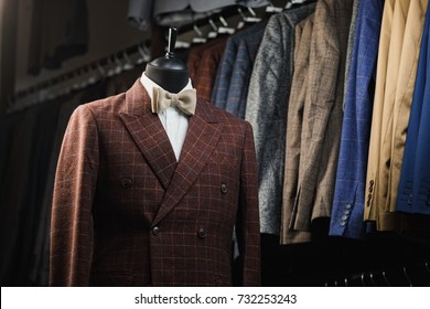men's suit, shirt, tie on a mannequin in the store
