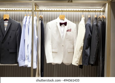 Mens suits on hangers in a clothes store