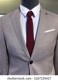 Men's suits with shirts and ties in clothing store