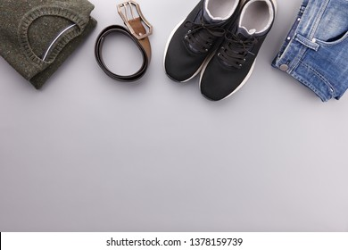 Mens summer casual clothing outfits and accessories flat lay on gray background, top view