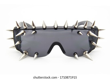 Men's sunglasses. Rocker glasses. Stylish glasses with spikes. Glasses on a white background.