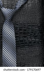 Men's tie lies on the natural leather, with space for your text