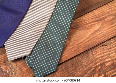 Men's ties on a wooden background.