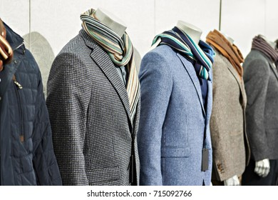 Men's tweed sport coats with scarves in the clothing store