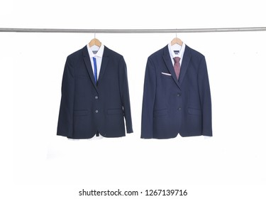 Men's two suits Shirts with ties on white hangers