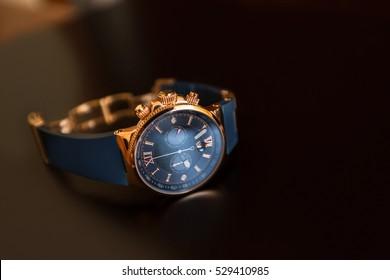 Men's watch, close-up golden hand watch. Best accessories for man