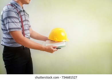 Mens wear casual outfits on Gray striped shirts and black pants with Construction worker drawing and yellow hat