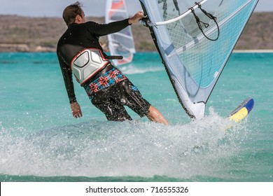 Men's windsurfer surfing in the lagoon