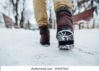Men's winter boots. Men's winter boots walking in the snow