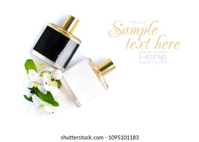 Men's and women's perfume with flowers on a white background, top view