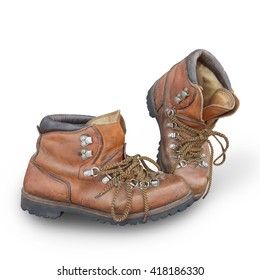 Men's Work brown Boots vintage hiking boots, well worn and muddy, isolated on white. this has clipping path.