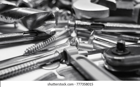 Men's working metal tools of silver color on the background