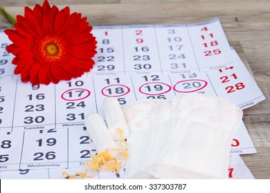 Menstruation calendar with cotton tampons ,sanitary pads, red flower .Woman critical days, woman hygiene protection