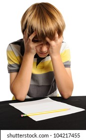 Mental Block. Nine year old elementary school student frustrated with his homework. Isolated on white.