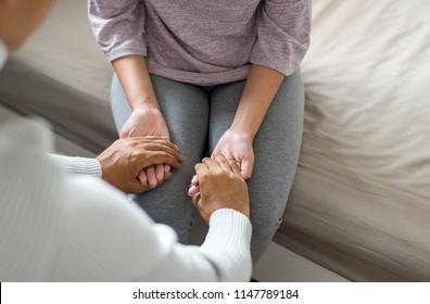 Mental health care and speech therapy concept,Male giving hand to depressed woman