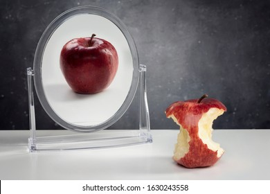 Mental Health Concept- Apple reflection on mirror.