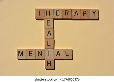 Mental, Health, Therapy, words in wooden alphabet letters in crossword for isolated on plain background