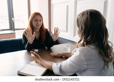 Mental health, wellness, support, emotional stress, therapy concept. Communication session of woman psychologist and client. Psychotherapy or talk therapy.