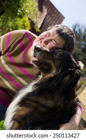 mentally disabled woman cuddles a dog