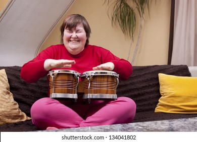Mentally disabled woman enjoys her music therapy