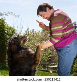 mentally disabled woman is feeding a dog