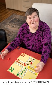 mentally disabled woman is gaming at home, daily routine and health