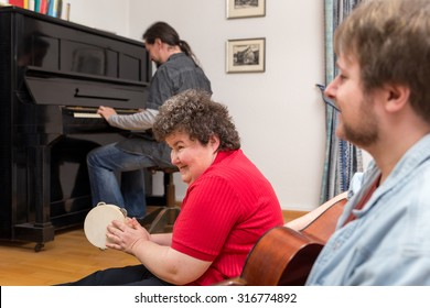a mentally disabled woman learning a music instrument