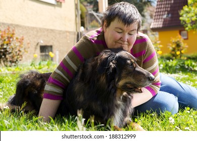 mentally disabled woman is lying with dog on a lawn
