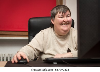 mentally disabled woman sitting at the computer, Education and Learning therapy