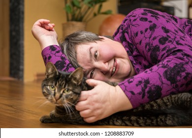 mentally disables woman cuddling a cat, animal assisted therapy